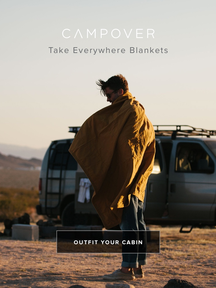 Staying warm with a Campover Blanket at Joshua Tree Campover Cabin in Joshua Tree, CA. Campover sells modern cabin supplies.